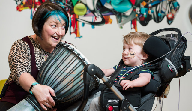 adult and child drumming